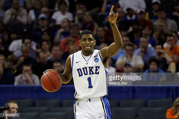Kyrie Irving of the Duke Blue Devils calls a play in the first half while taking on the Hampton Pirates during the second round of the 2011 NCAA...