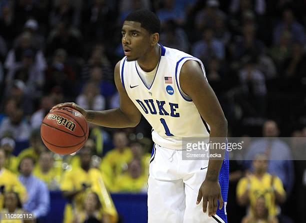 Kyrie Irving of the Duke Blue Devils moves the ball while taking on the Michigan Wolverines during the third round of the 2011 NCAA men's basketball...