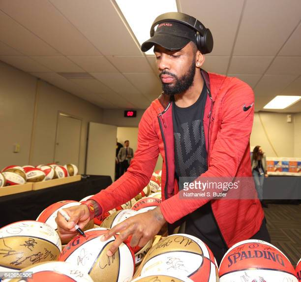 Kyrie Irving of the Eastern Conference All Star Team signs balls before NBA AllStar Practice as part of 2017 AllStar Weekend at the MercedesBenz...