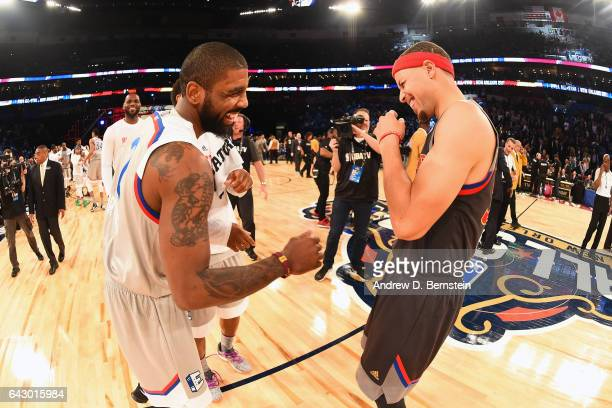 Kyrie Irving of the Eastern Conference AllStar Team shares a laugh with Stephen Curry of the Western Conference AllStar Team during the NBA AllStar...