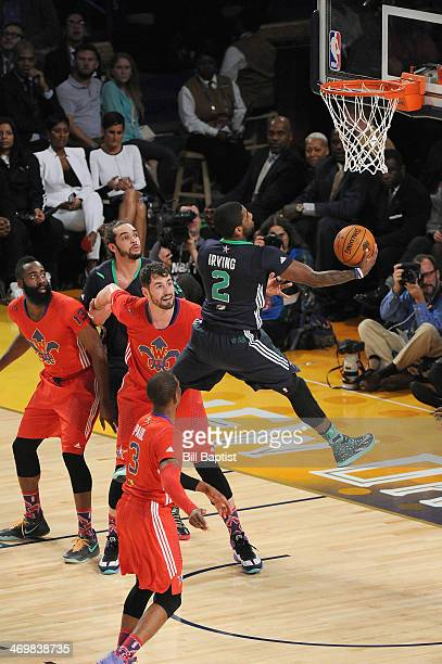 Kyrie Irving of the Eastern Conference AllStars shoots against Kevin Love of the Western Conference AllStars during the 2014 NBA AllStar Game at...