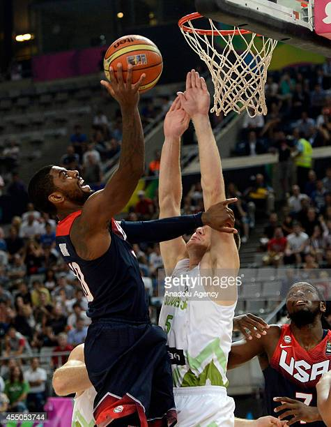 Kyrie Irving of the US in action against Uros Slokar of Slovenia during the 2014 FIBA Basketball World Cup quarter final match between Slovenia and...