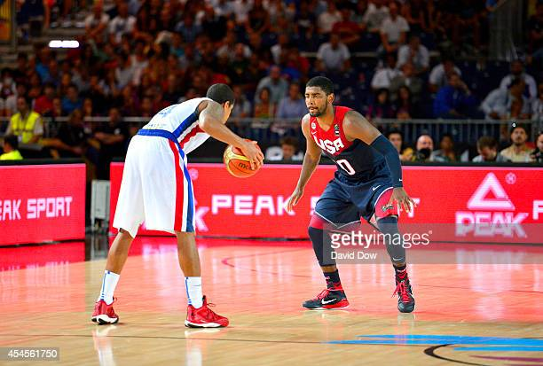Kyrie Irving of the USA Basketball Men's National Team defends during the game against the Dominican Republic Basketball Men's National Team during...