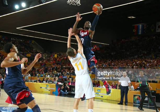 Kyrie Irving of the USA Basketball Men's National Team goes up to shoot against Dmytro Zabirchenko of the Ukraine Basketball Men's National Team...