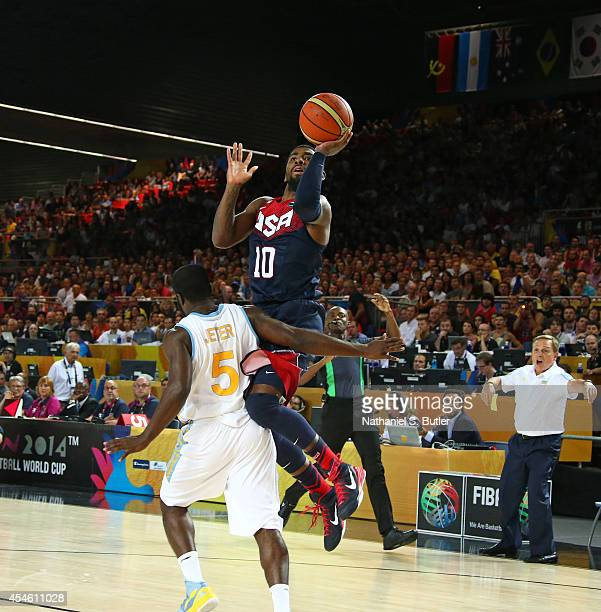 Kyrie Irving of the USA Basketball Men's National Team goes up to shoot against Eugene Pooh Jeter of the Ukraine Basketball Men's National Team...