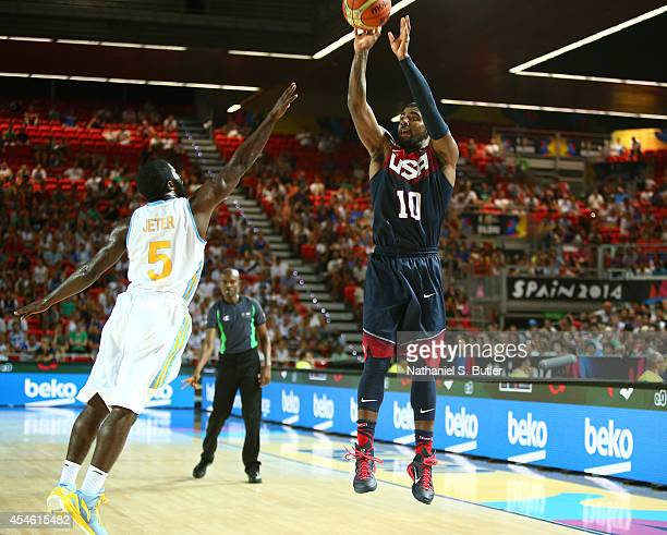 Kyrie Irving of the USA Basketball Men's National Team shoots against Eugene Pooh Jeter of the Ukraine Basketball Men's National Team during the 2014...