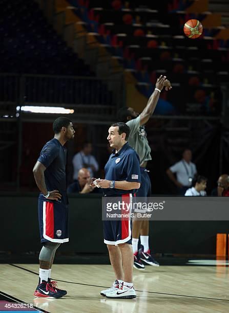 Kyrie Irving of the USA Basketball Men's National Team talks with Head Coach Mike Krzyzewski of the USA Basketball Men's National Team during a...