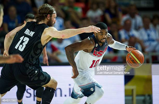 Kyrie Irving of the USA drives against Casey Frank of New Zealand during their game at the Bilbao Exhibition Center on September 2, 2014 in Bilbao,...