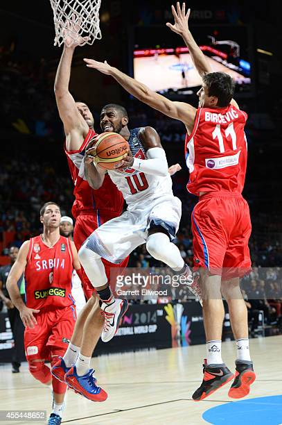 Kyrie Irving of the USA Men's National Team shoots against the Serbia National Team during the 2014 FIBA World Cup Finals at Palacio de Deportes on...