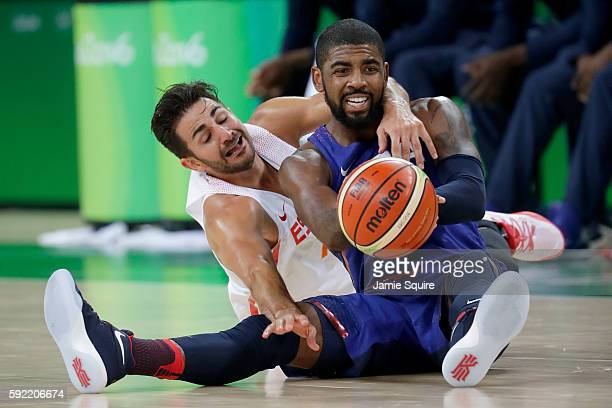 Kyrie Irving of United States goes for the loose ball against Ricky Rubio of Spain during the Men's Semifinal match on Day 14 of the Rio 2016 Olympic...