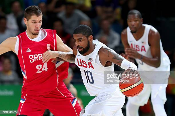 Kyrie Irving of United States handles the ball against Stefan Jovic of Serbia in the Men's Preliminary Round Group A match on Day 7 of the Rio 2016...