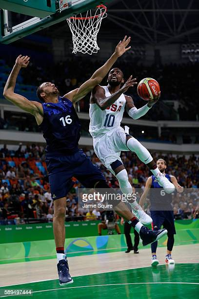 Kyrie Irving of United States shoots against Rudy Gobert of France during a Men's Preliminary Round Group A game between the United States and France...