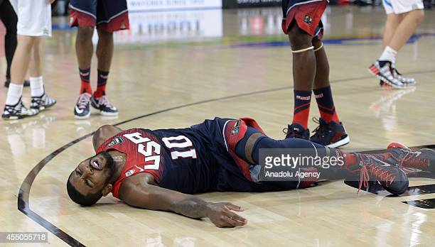 Kyrie Irving of USA gets injured during the 2014 FIBA Basketball World Cup quarter final match between Slovenia and USA at the Palau Sant Jordi in...