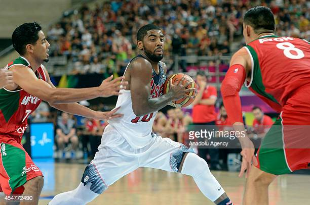 Kyrie Irving of USA in action against Jorge Gutierrez of Mexico during the 2014 FIBA Basketball World Cup Round of 16 match between United States and...