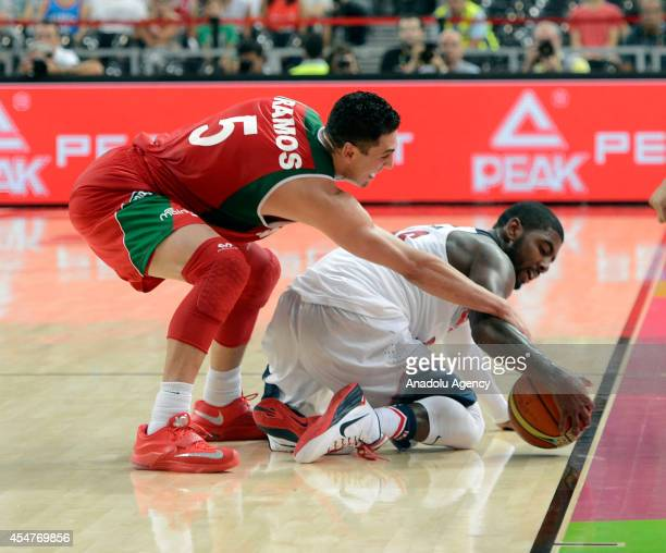 Kyrie Irving of USA in action against Marco Ramos of Mexico during the 2014 FIBA Basketball World Cup Round of 16 match between United States and...