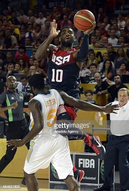 Kyrie Irving of USA is in action against Eugene Jeter of Ukraine during the 2014 FIBA World Basketball Championships Group C basketball match between...