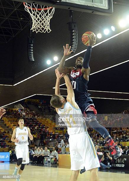 Kyrie Irving of USA is in action against Maxym Kornienko of Ukraine during the 2014 FIBA World Basketball Championships Group C basketball match...
