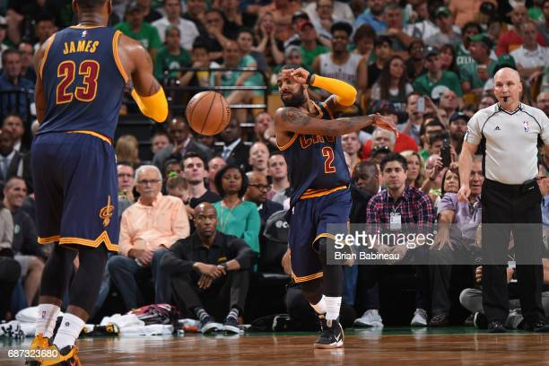 Kyrie Irving passes the ball to LeBron James of the Cleveland Cavaliers in Game Two of the Eastern Conference Finals against the Boston Celtics...
