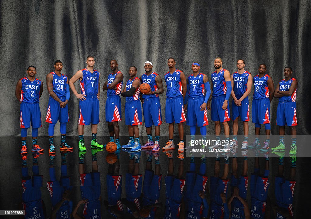 Kyrie Irving #2, Paul George #24, Brook Lopez #11, Kevin Garnett #5, Dwyane Wade #3, LeBron James #6, Chris Bosh #1, Carmelo Anthony #7, Tyson Chandler #6, Joakim Noah #13, Luol Deng #9, and Jrue Holiday #11 of the Eastern Conference All-Stars poses for portraits prior to the 2013 NBA All-Star Game at Toyota Center on February 17, 2013 in Houston, Texas.