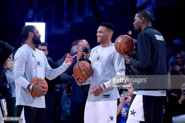 70ce3af57b3a Kyrie Irving Russell Westbrook and Kevin Durant warm up at the 67th NBA  AllStar Game Team