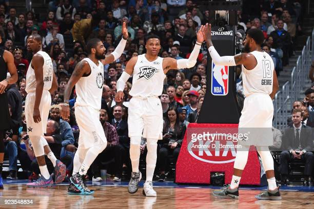 Kyrie Irving Russell Westbrook and Paul George of team LeBron exchange high fives during the NBA AllStar Game as a part of 2018 NBA AllStar Weekend...
