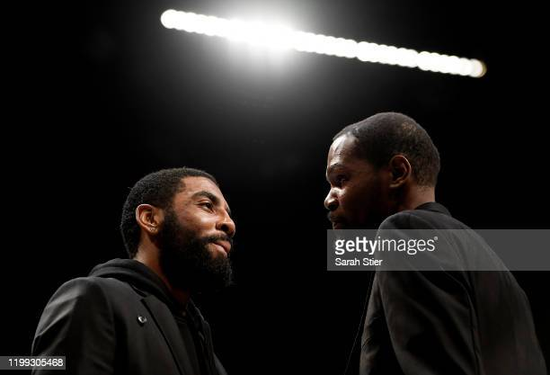 Kyrie Irving talks with Kevin Durant of the Brooklyn Nets during a timeout during the first half of the game against the Miami Heat at Barclays...