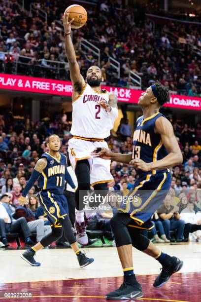 Kyrie Irving throws up an alley oop for Tristan Thompson of the Cleveland Cavaliers over Myles Turner of the Indiana Pacers during the first overtime...