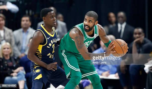 Kyrie Irving#11 of the Boston Celtics is defended by Darren Collison of the Indiana Pacers during the game at Bankers Life Fieldhouse on December 18...