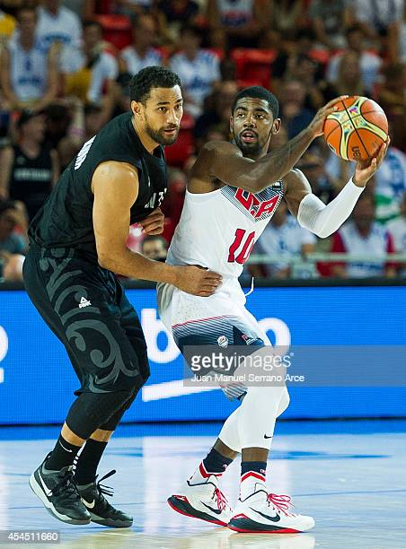 Kyrie Irving the USA drives against Corey Webster of New Zealand during their game at the Bilbao Exhibition Center on September 2, 2014 in Bilbao,...