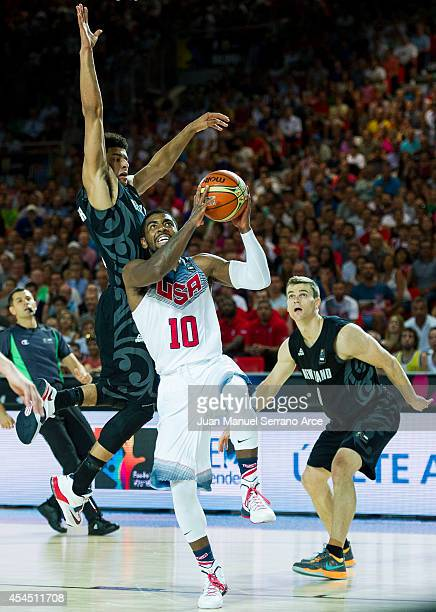Kyrie Irving the USA drives against Tai Webster of New Zealand during their game at the Bilbao Exhibition Center on September 2, 2014 in Bilbao,...