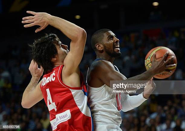 Kyrie rving of USA in action against Milos Teodosic of Serbia during the 2014 FIBA World Cup Final basketball match between USA and Serbia at the...