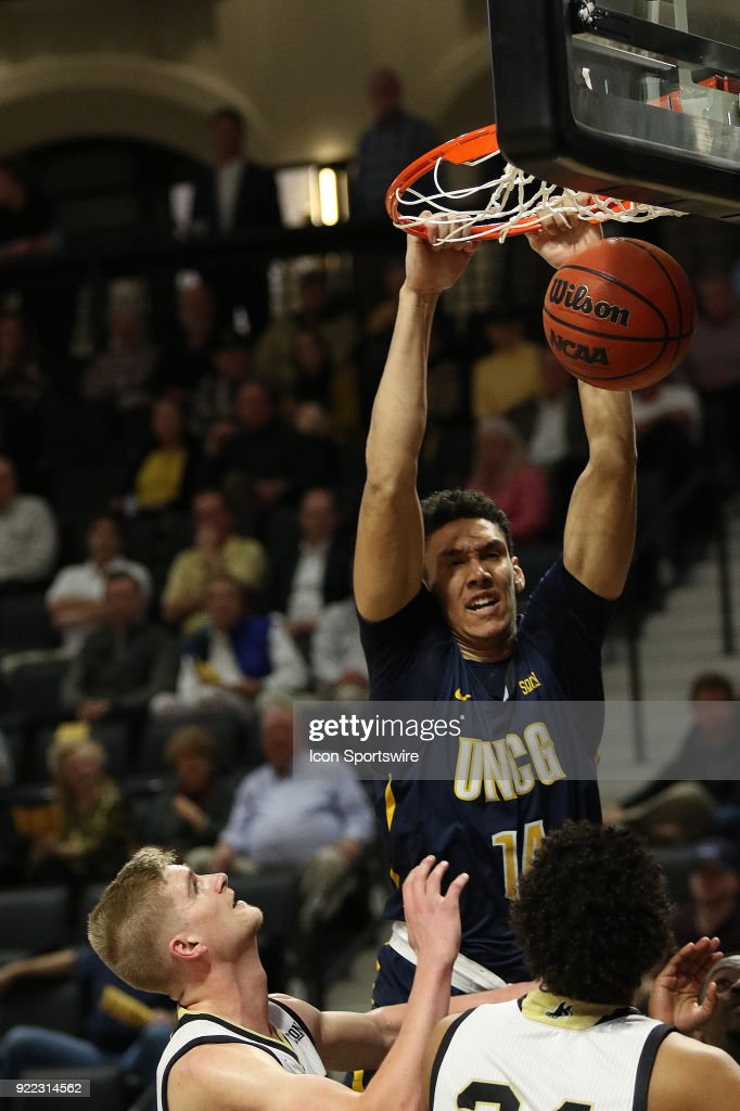 Kyrin Galloway (14) UNC Greensboro gets a dunk during action against Wofford at Jerry Richard indoor stadium in Spartanburg,SC on Tuesday February 20, 2018.