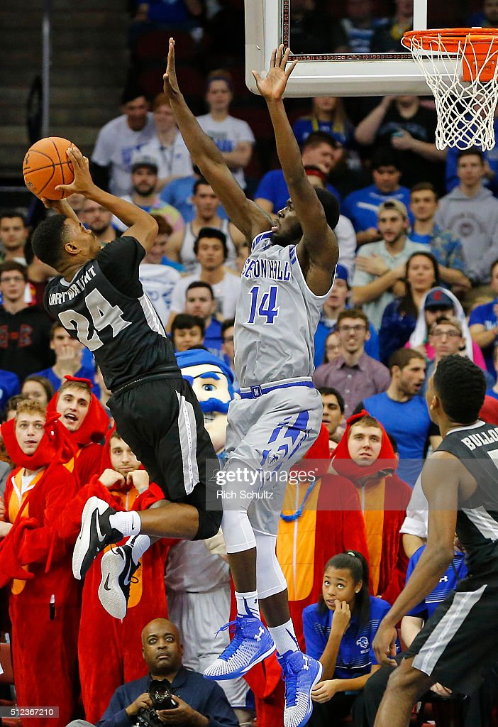 Kyron Cartwright #24 of the Providence Friars attempts a shot as Ismael Sanogo #14 of the Seton Hall Pirates defends during the second half of an NCAA college basketball game on February 25, 2016 at the Prudential Center in Newark, New Jersey. Seton Hall defeated Providence 70-52.
