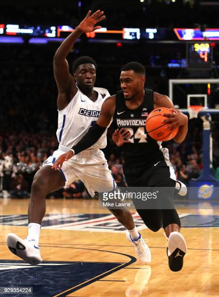 Kyron Cartwright of the Providence Friars handles the ball against Khyri Thomas of the Creighton Bluejays in the first half during the Big East...