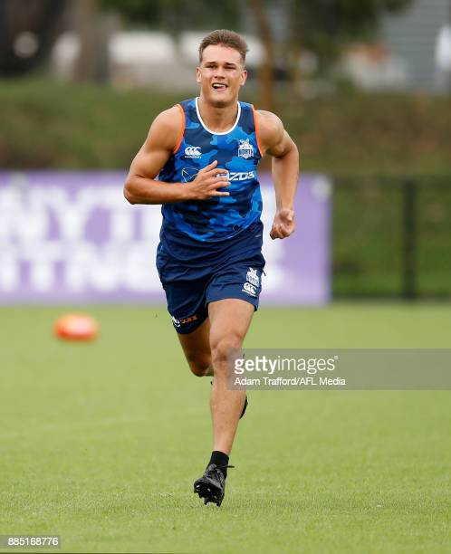 Kyron Hayden of the Kangaroos runs sprints during the North Melbourne Kangaroos training session at Arden St on December 4 2017 in Melbourne Australia