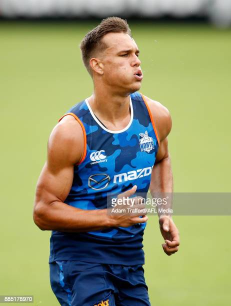 Kyron Hayden of the Kangaroos runs the yoyo test during the North Melbourne Kangaroos training session at Arden St on December 4 2017 in Melbourne...