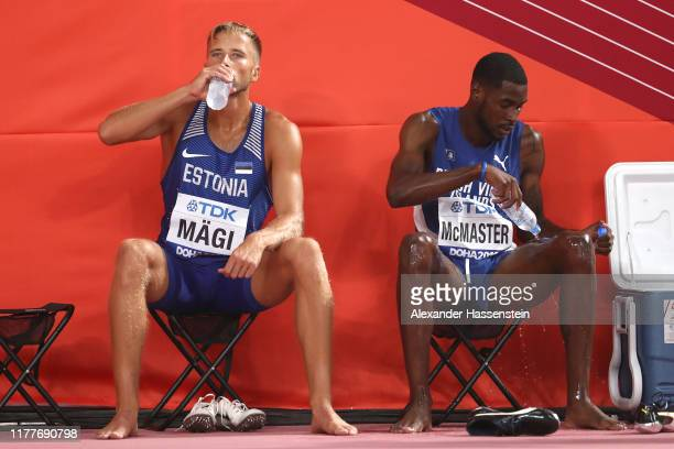 Kyron Mcmaster of Virgin Islands British and Rasmus Mägi of Estonia cool off after the Men's 400 metres hurdles heats during day two of 17th IAAF...