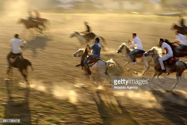 Kyrygz Turks play the traditional Central Asian sport Buzkashi in Turkey's eastern city of Van on July 21 2015 Kyrygz Turks living in Ulupamir...