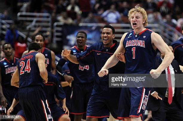 Kyryl Natyazhko and the bench of the Arizona Wildcats celebrate after a play against the Duke Blue Devils during the west regional semifinal of the...