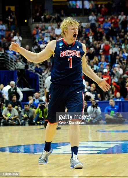 Kyryl Natyazhko of the Arizona Wildcats reacts after a play against the Duke Blue Devils during the west regional semifinal of the 2011 NCAA men's...