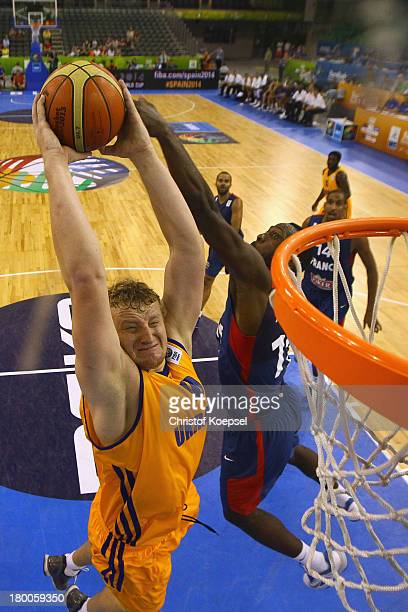 Kyryl Natyazhko of Ukriane dunks the ball against Mickael Gelabale of France during the FIBA European Championships 2013 first round group A match...
