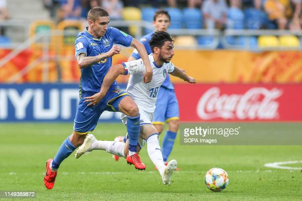 Kyrylo Dryshliuk of Ukraine and Roberto Alberico of Italy are seen in action during the FIFA U-20 World Cup match between Ukraine and Italy in...