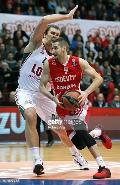 Kyrylo Fesenko #44 of Lokomotiv Kuban Krasnodar competes with Luka Babic #9 of Cedevita Zagreb during the Turkish Airlines Euroleague Basketball Top...