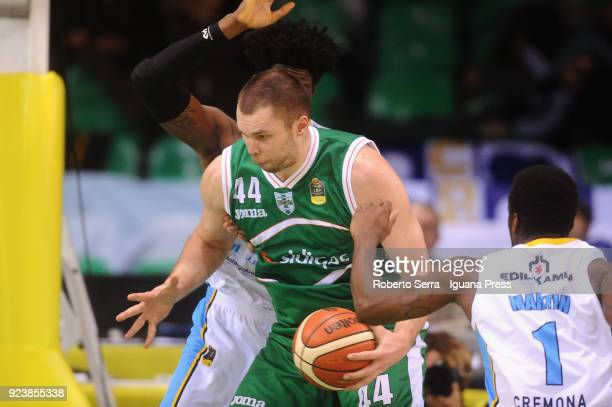 Kyrylo Fesenko of Sidigas competes with Henry Sims and Kelvin Martin of Vanoli during the match quarter final of Coppa Italia between Scandone...