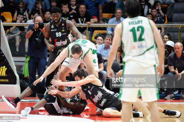 Kyrylo Fesenko of Sidigas competes with Jamil Wilson and Oliver Lafayette and Klaudio Ndoja of Segafredo during the LBA LegaBasket match between...