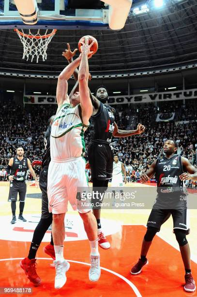 Kyrylo Fesenko of Sidigas competes with Pietro Aradori Marcus Slaughter Jamil Wilson Oliver Lafayette of Segafredo during the LBA LegaBasket match...