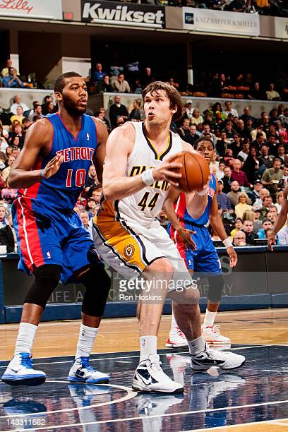 Kyrylo Fesenko of the Indiana Pacers drives against Greg Monroe of the Detroit Pistons on April 23 2012 at Bankers Life Fieldhouse in Indianapolis...