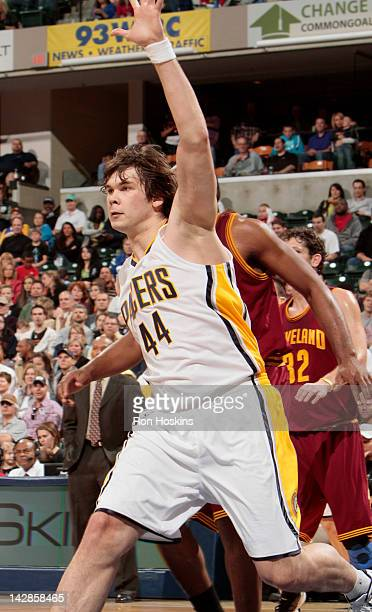 Kyrylo Fesenko of the Indiana Pacers looks for a pass during the game against the Cleveland Cavaliers on April 13 2012 at Bankers Life Fieldhouse in...