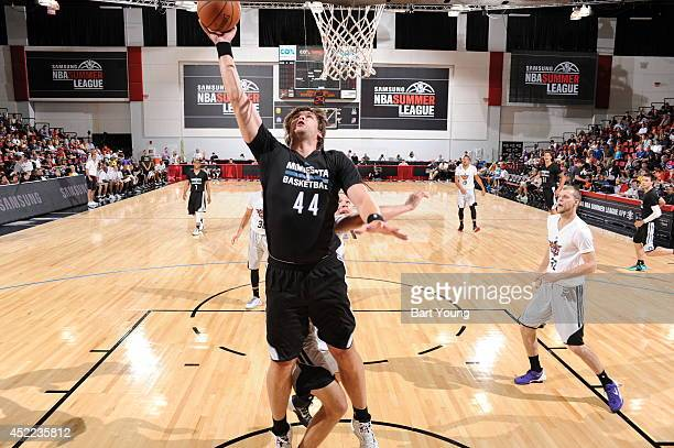 Kyrylo Fesenko of the Minnesota Timberwolves goes up for the layup against the Phoenix Suns on July 16 2014 at the Cox Pavilion in Las Vegas Nevada...