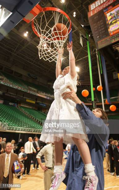 Kyrylo Fesenko of the Utah Jazz hoists fan Sage Whipple up for a dunk during the Leapin' Leaners and Low Tops charity event at EnergySolutions Arena...